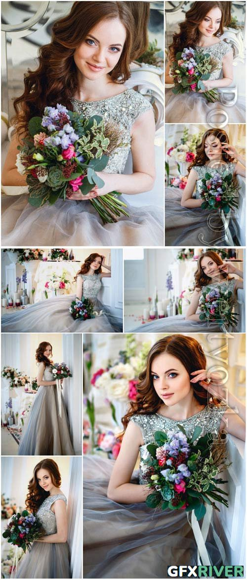 Girl in evening dress with a bouquet of flowers stock photo